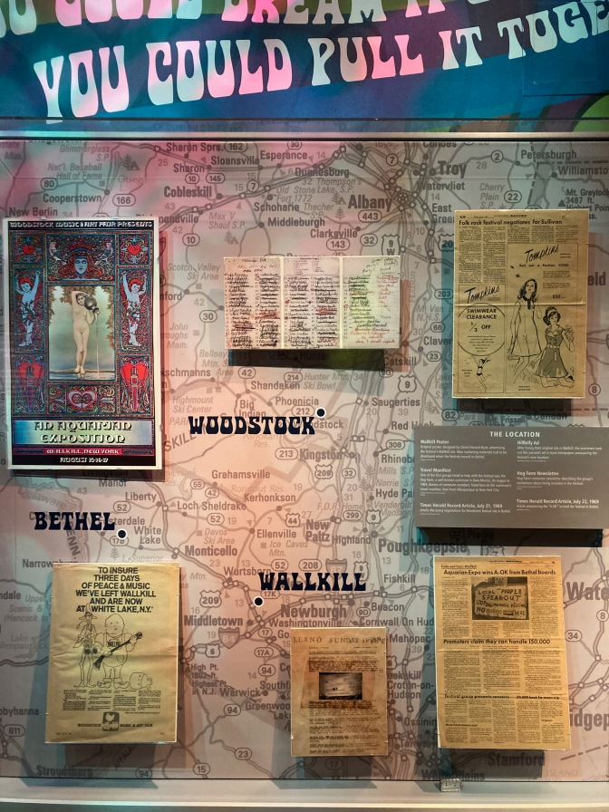 Display with map of New York, along with posters and memorabilia from concert.