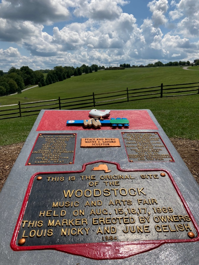 Stone marker that says THIS IS THE ORIGINAL SITE OF THE WOODSTOCK MUSIC AND ARTS FAIR HELD ON AUG 15,16,17 1969