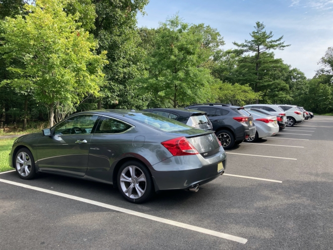 2012 Honda Accord coupe parked in row of cars in parking lot.