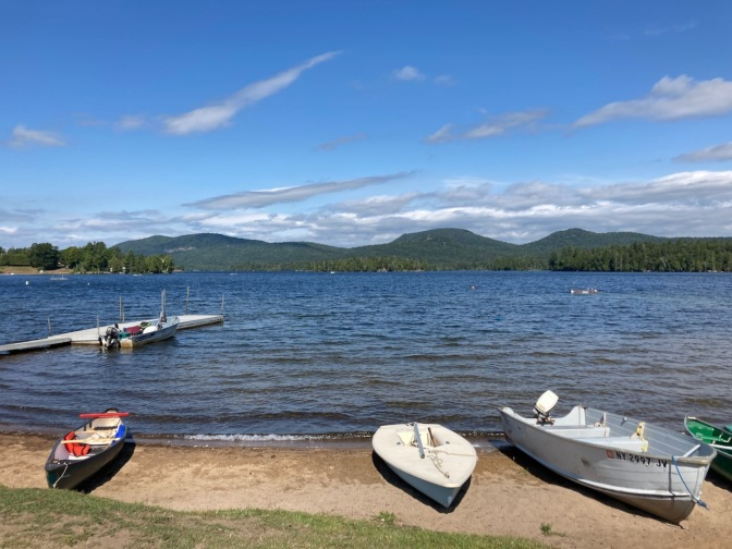 Blue Mountain Lake, with boats in foreground.