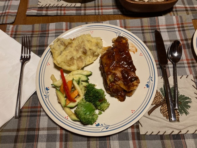 White plate with meatloaf, mashed potatoes, and mixed vegetables.