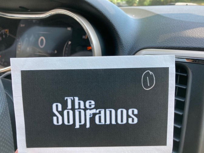 Index card with The Sopranos logo on it and a #1 written on the card.