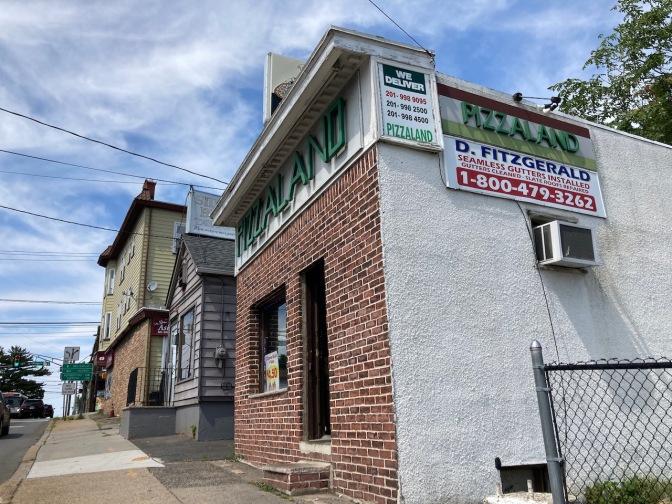 Exterior of Pizza Land pizzeria.
