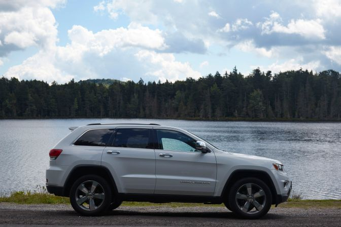 2014 Jeep Grand Cherokee parked in front of Quiver Pond.