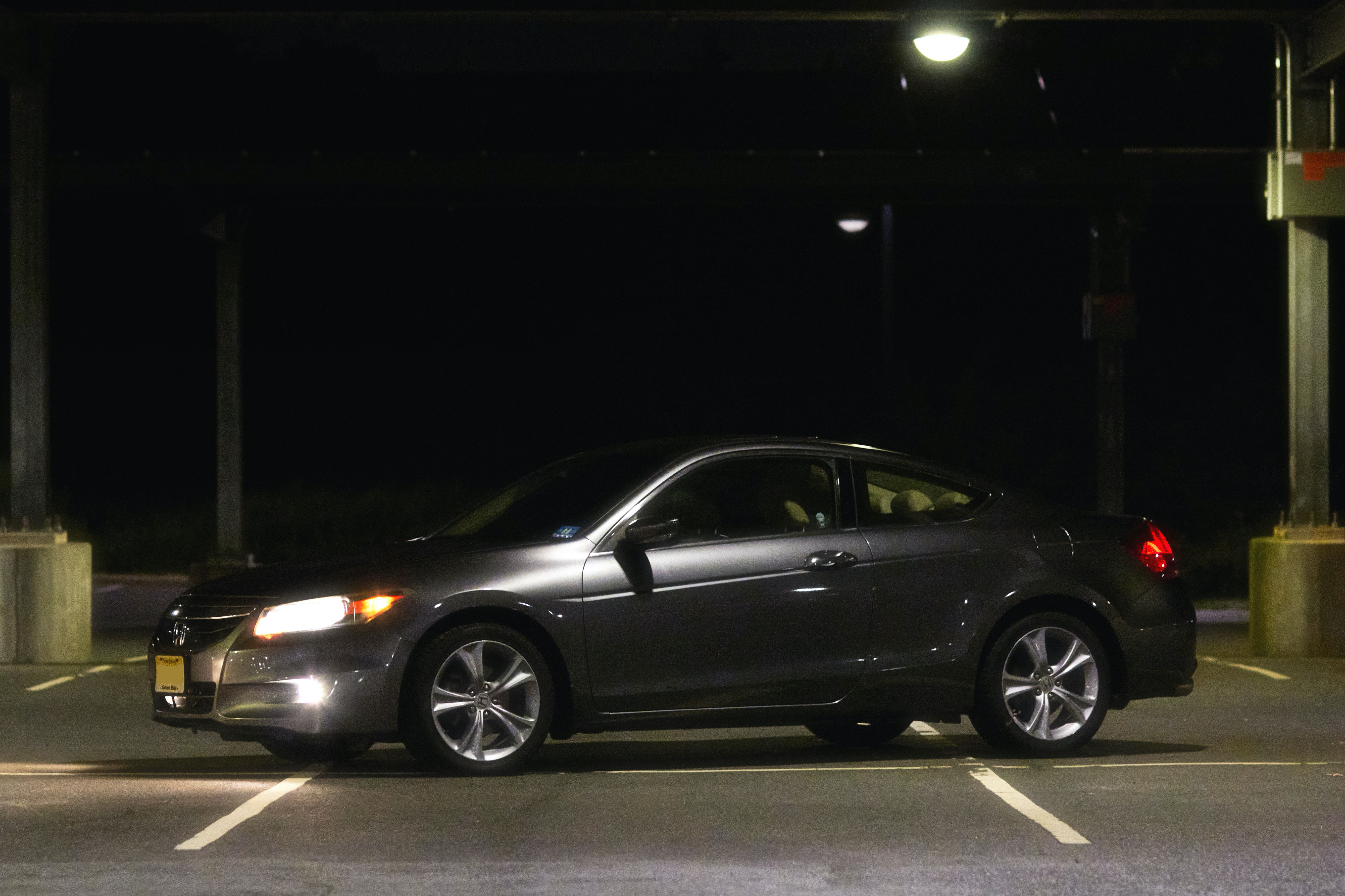 2012 Honda Accord coupe, parked in parking lot at night.