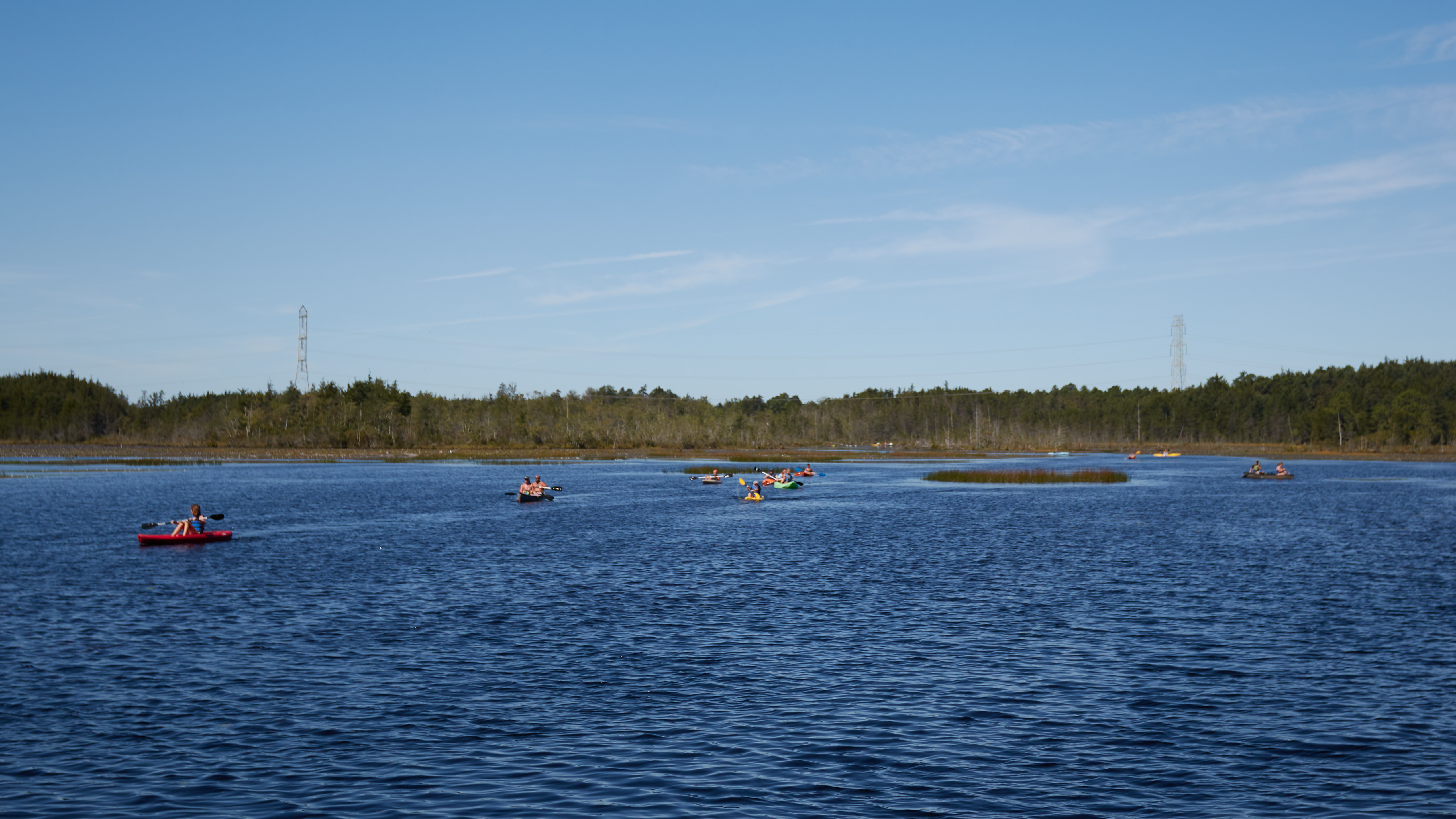 Mill Pond reservoir, with kayakers on the water.