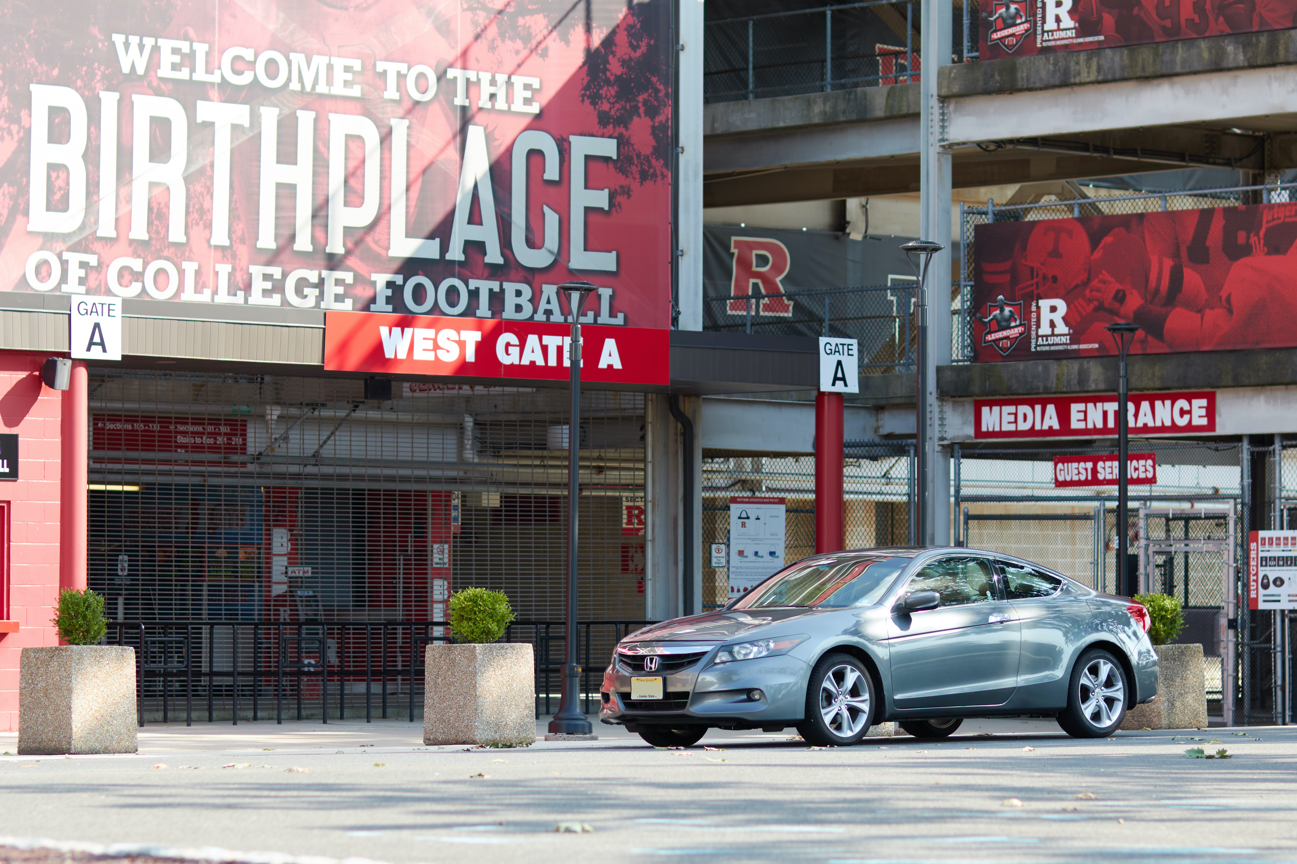 2012 Honda Accord parked in front of West Gate A at Shi Stadium.