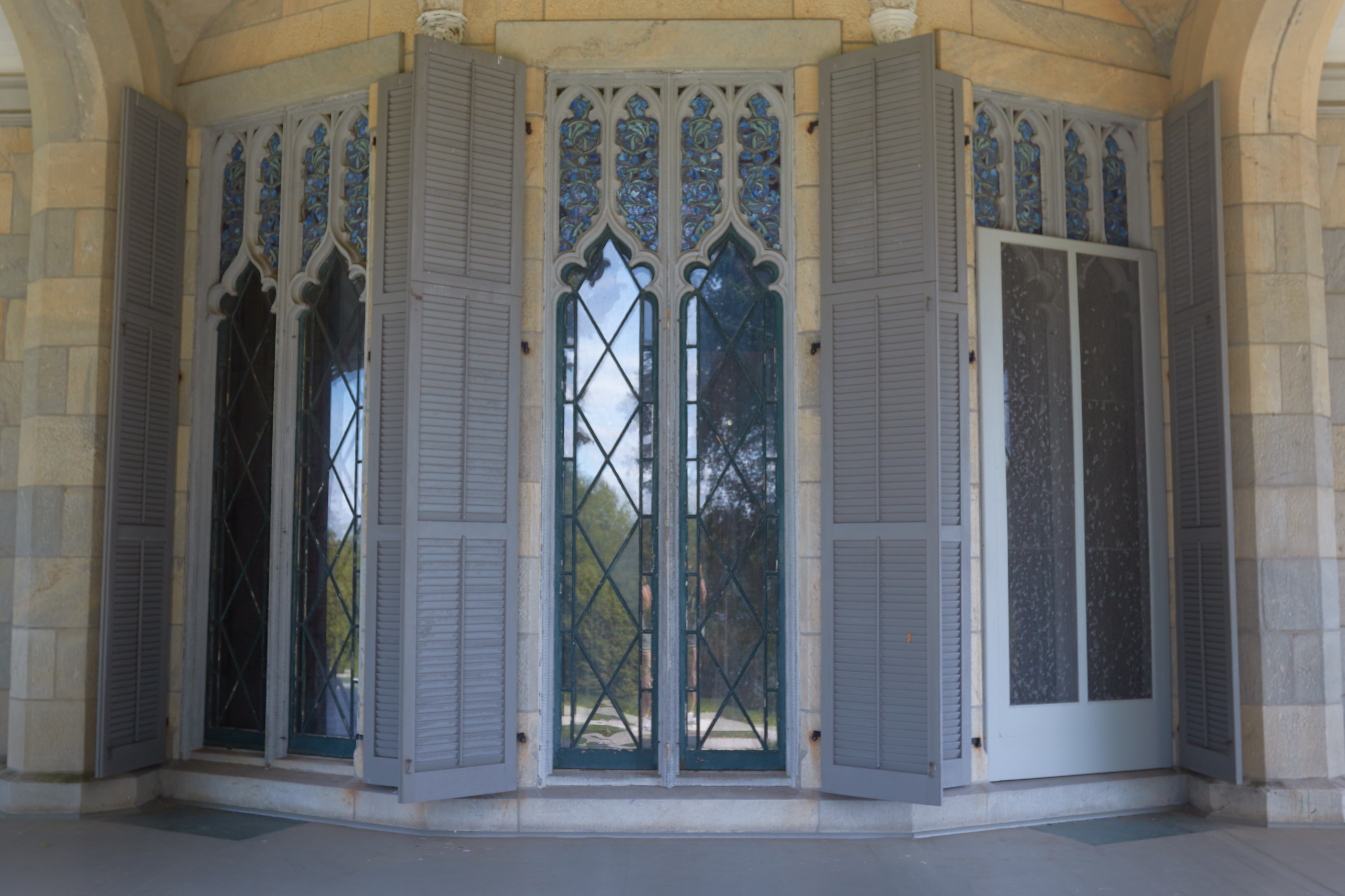Floor-to-ceiling windows of house, from exterior.