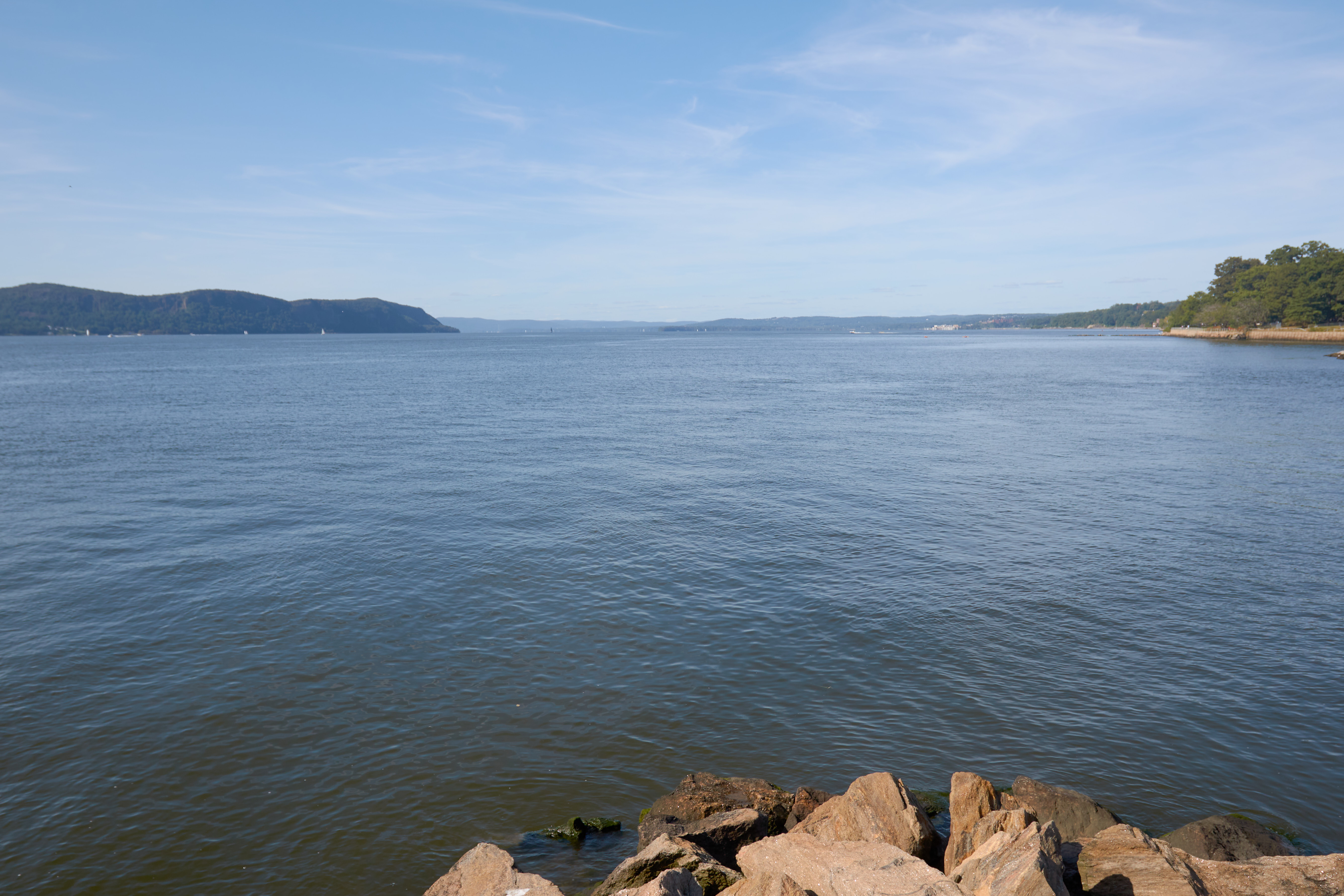 View of Hudson River, with rocks in foreground.