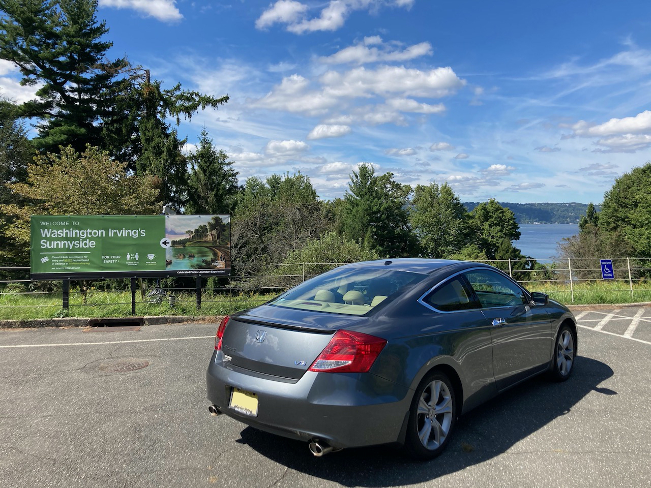 2012 Honda Accord parked in front of sign for Washington Irving's Sunnyside. The Hudson River is in the distance.