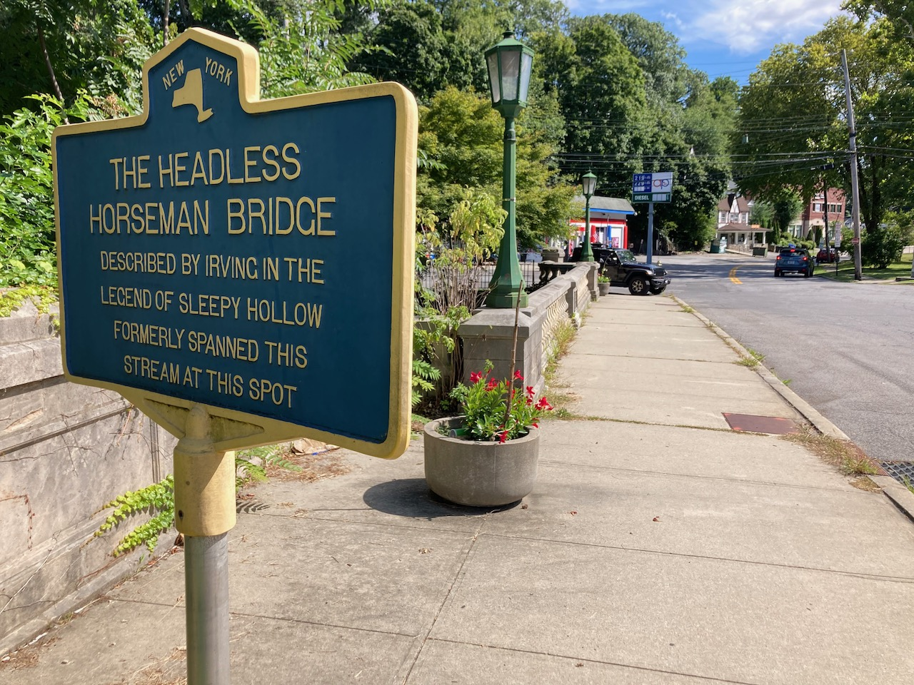 Sign that read THE HEADLESS HORSEMAN BRIDGE DESCRIBED BY IRVING IN THE LEGEND OF SLEEPY HOLLOW FORMERLY SPANNED THIS STREAM AT THIS SPOT.
