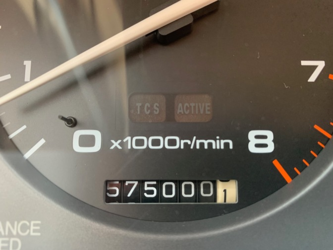 Car odometer reading 575000.1 miles