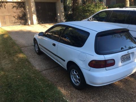 1992 white Honda Civic VX parked in driveway