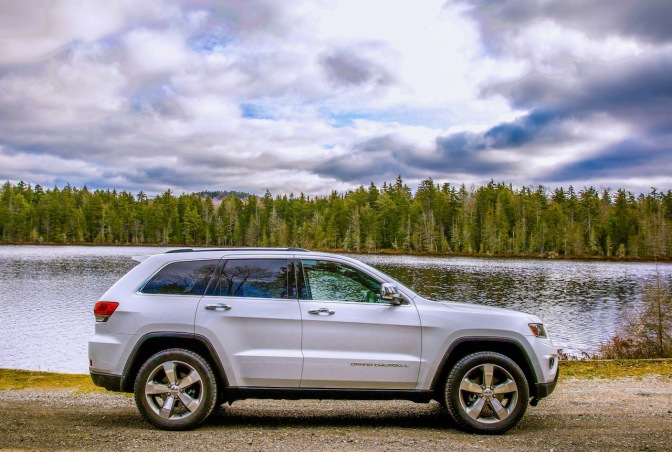 White Jeep Grand Cherokee parked in front of Quiver Pond.