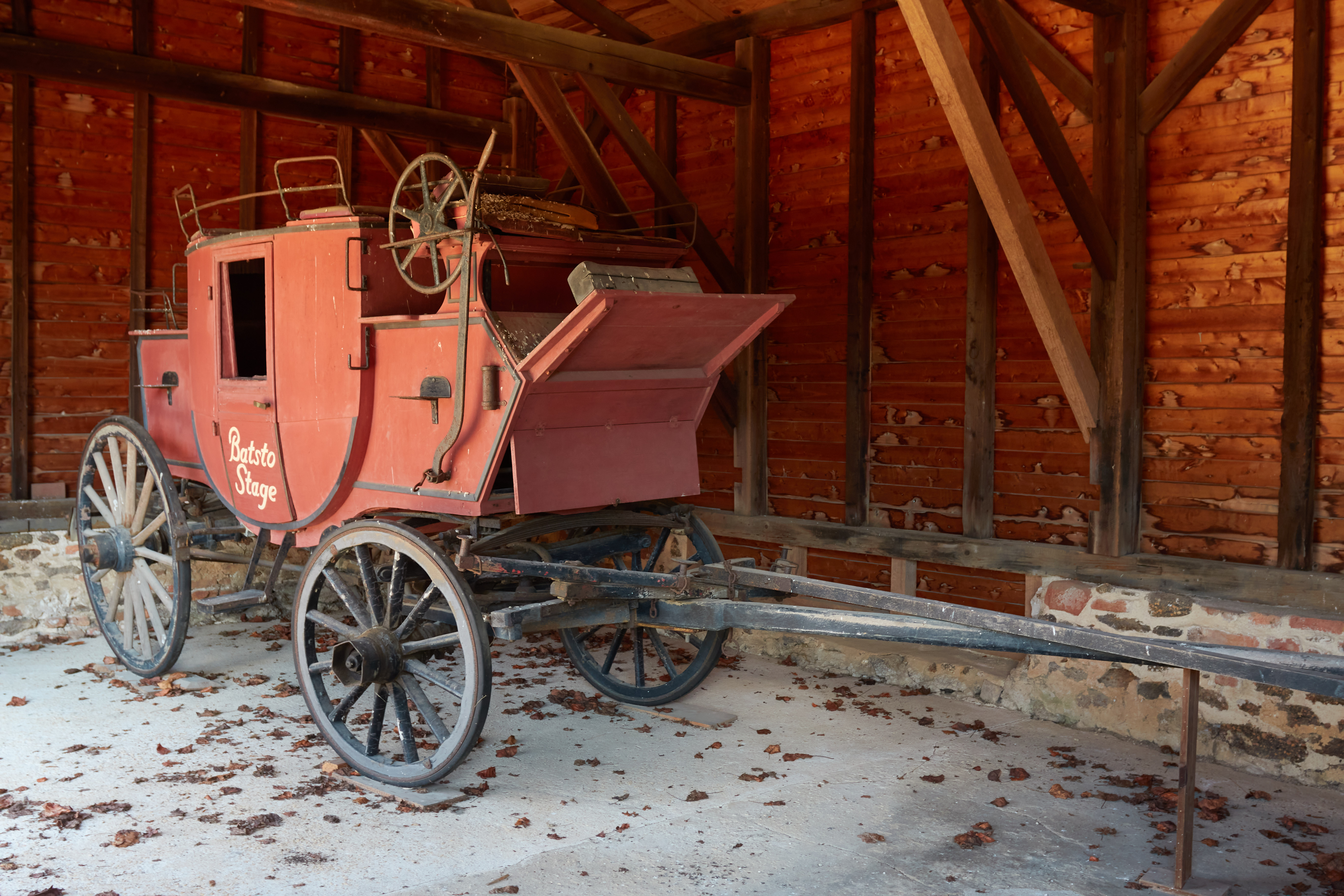 Stagecoach in barn.