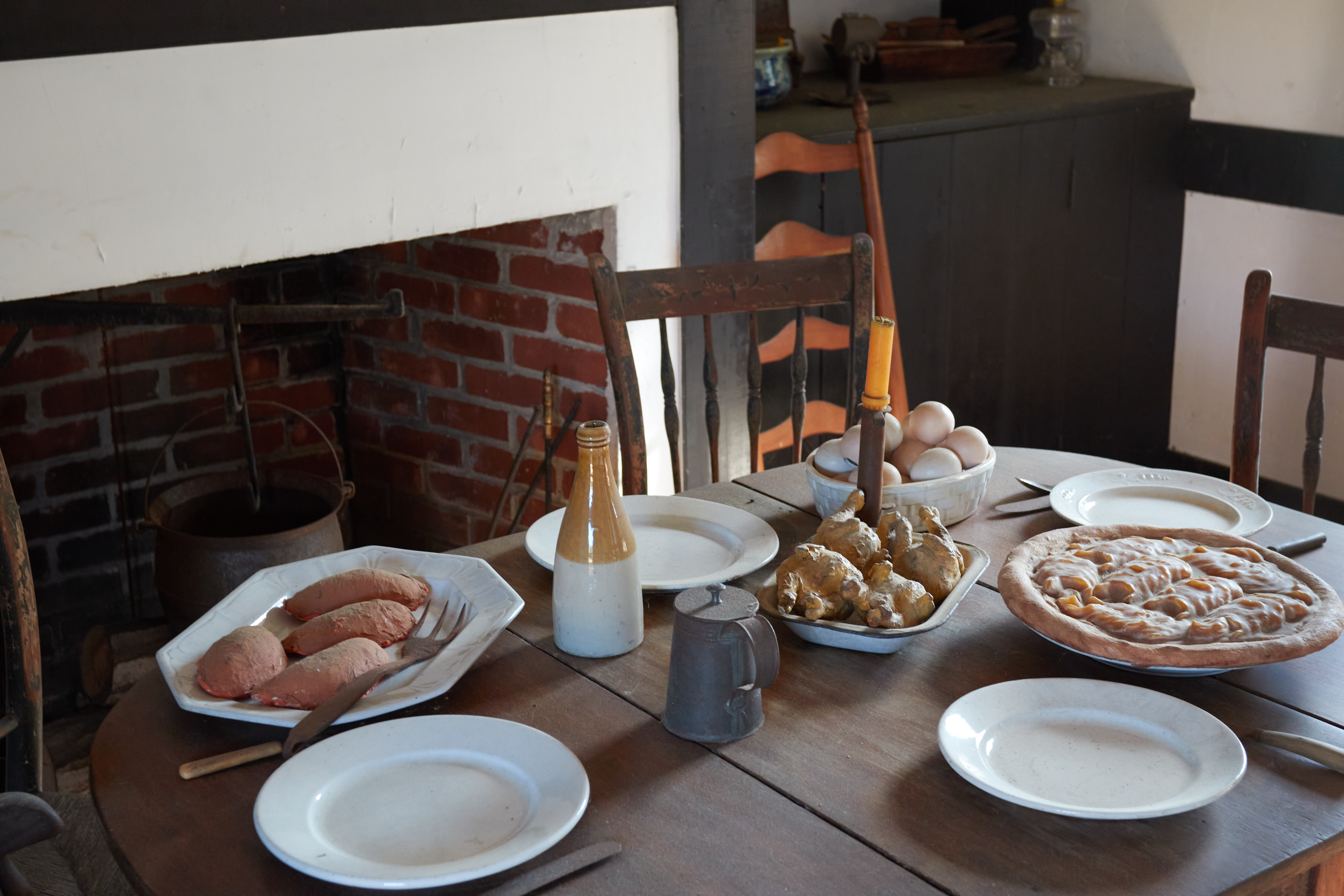 Kitchen table in cottage with food.