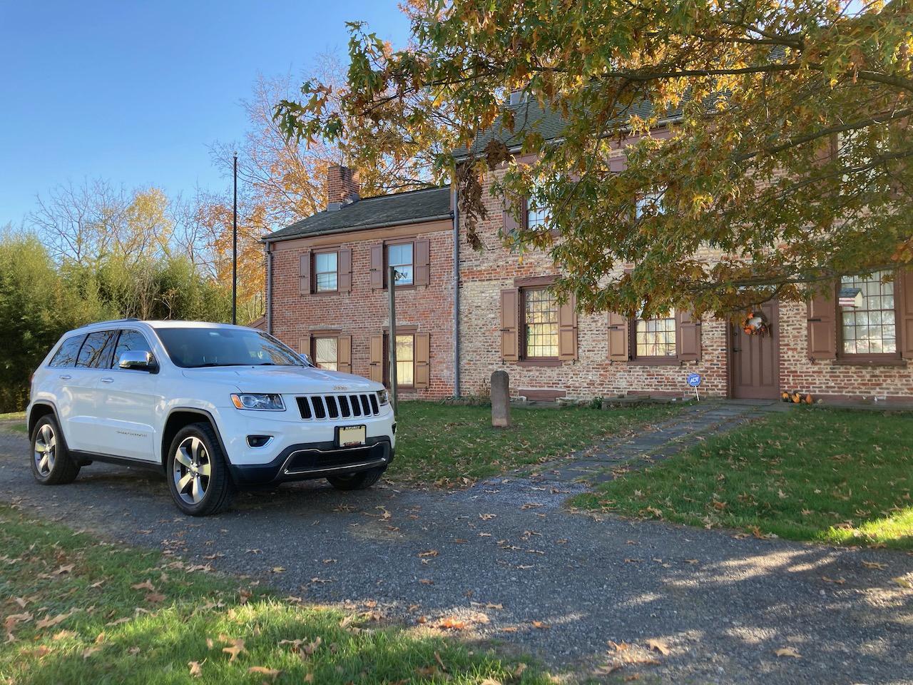2014 Jeep Grand Cherokee parked in front of Van Veghten House.