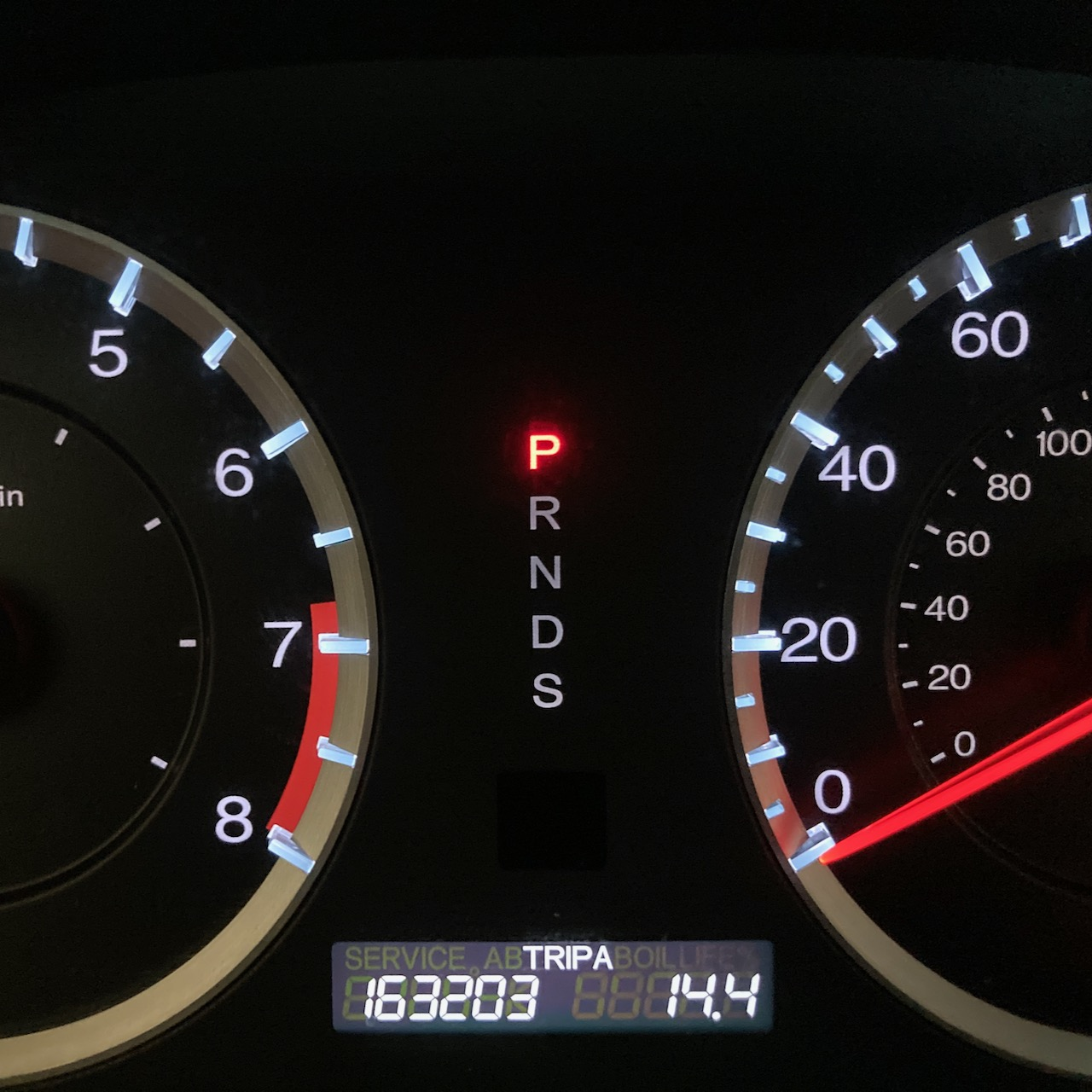 Car odometer reading 163203 TRIP A 14.4