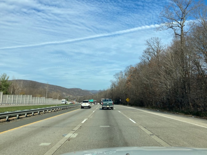 View of New York Thruway on sunny day with some clouds.