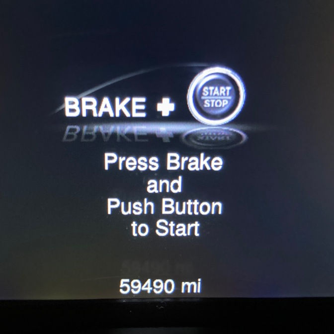 Car odometer reading 59490 miles.