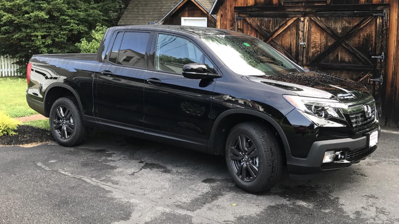 Black 2017 Honda Ridgeline pickup truck.
