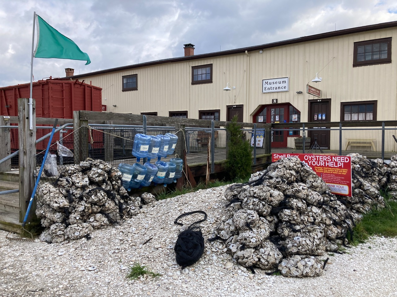 Bags of oysters beside museum entrance.