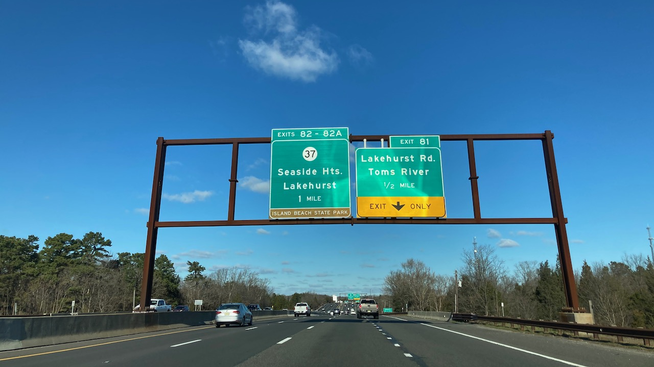 Signs over Garden State Parkway for Seaside Heights exit and Lakehurst Road exit.
