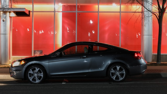 2012 Honda Accord parked in front of building with red wall.