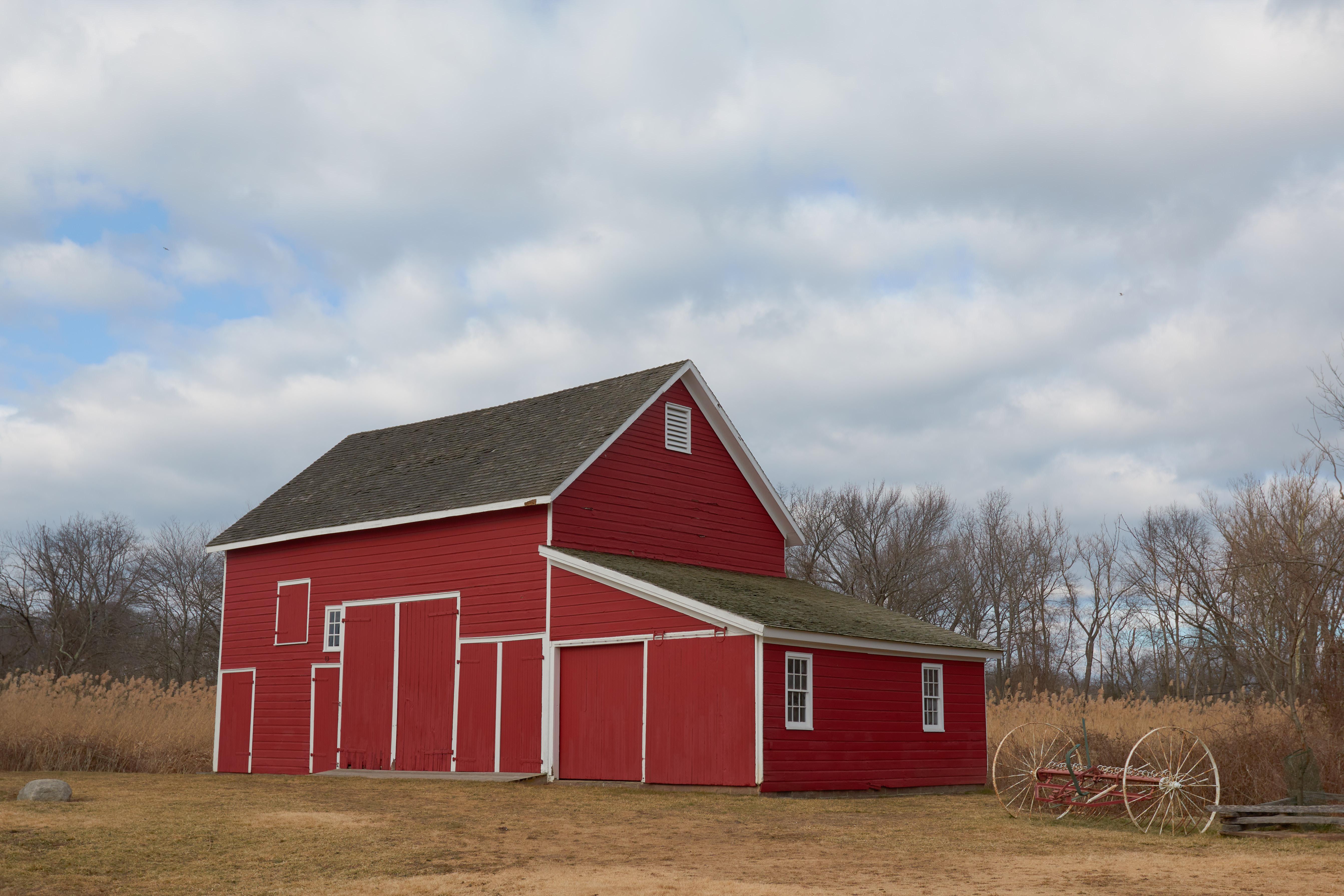 Red barn in field.