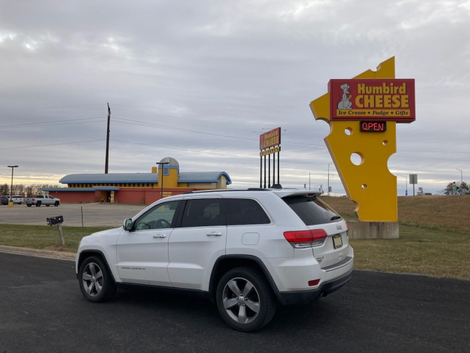 2014 Jeep Grand Cherokee, parked in front of Humbird Cheese sign.