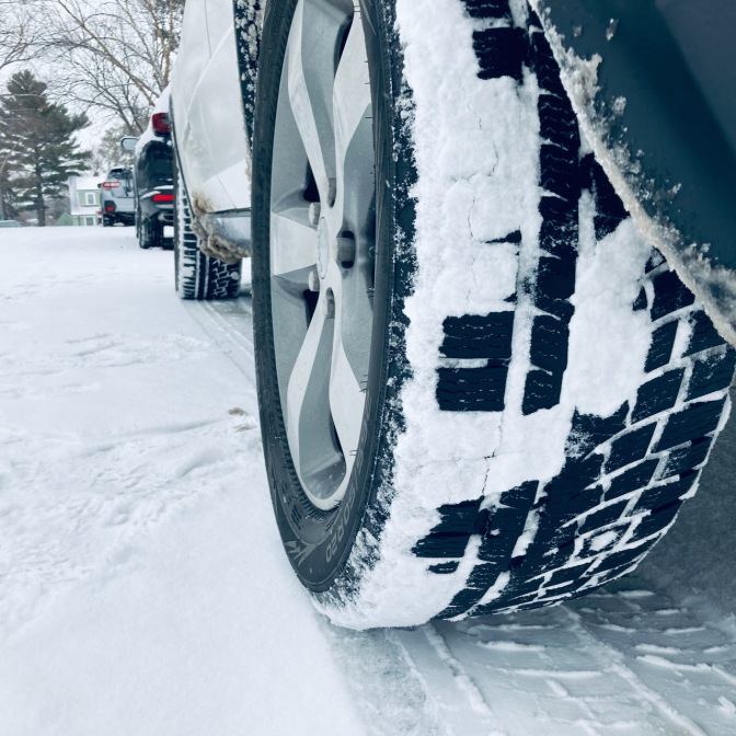 Jeep with Nokian WR G4 tires in snow. The tires are covered in snow.