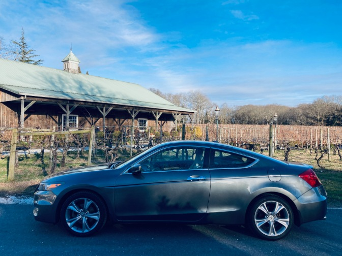 2012 Honda Accord coupe parked in front of vineyard.