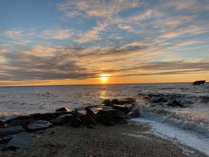 View of Sunset Beach as sun lowers in horizon.