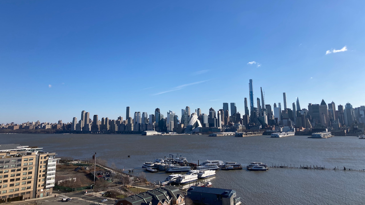 View of Manhattan skyline from banks of Hudson River in Weehawken.