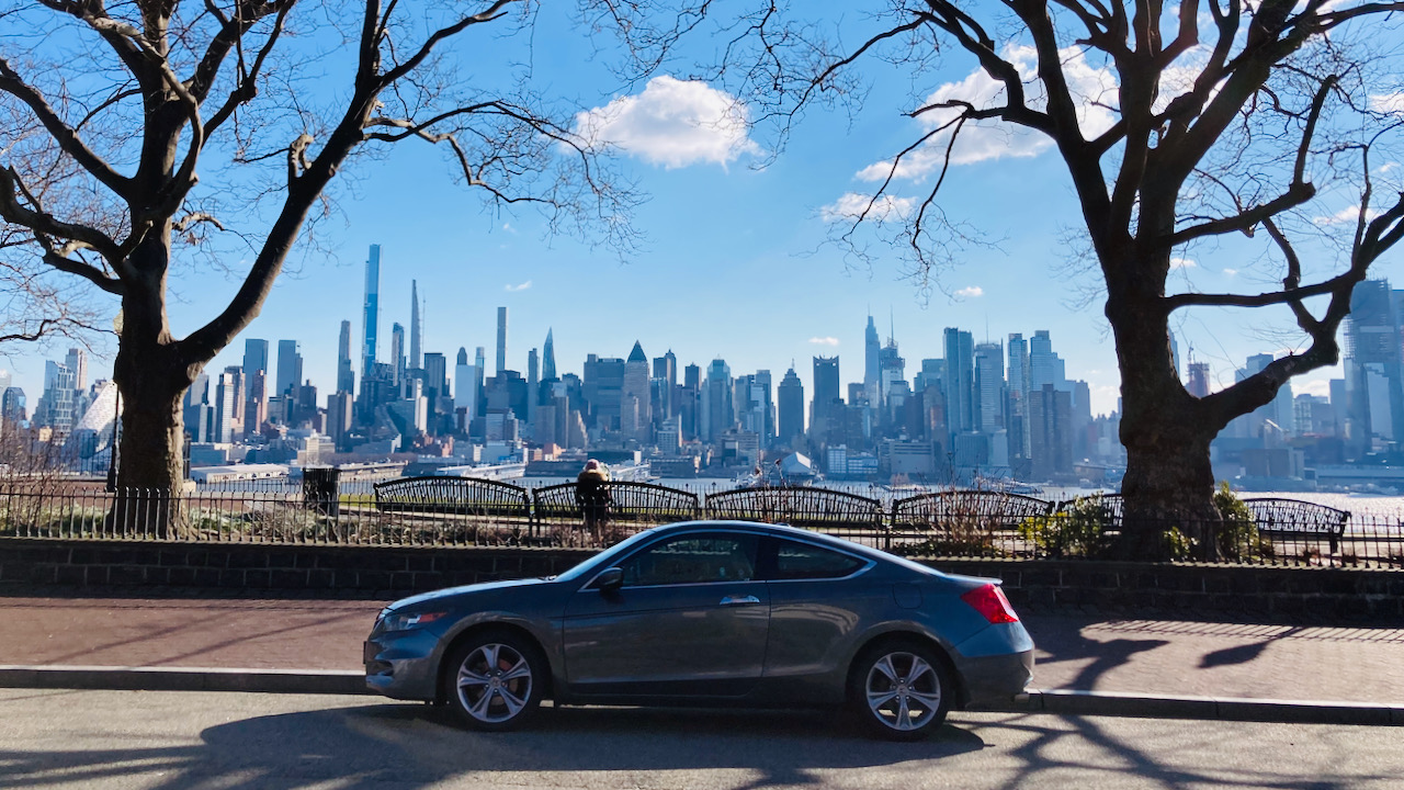 2012 Honda Accord parked in front of esplanade. The Manhattan skyline is in the background.