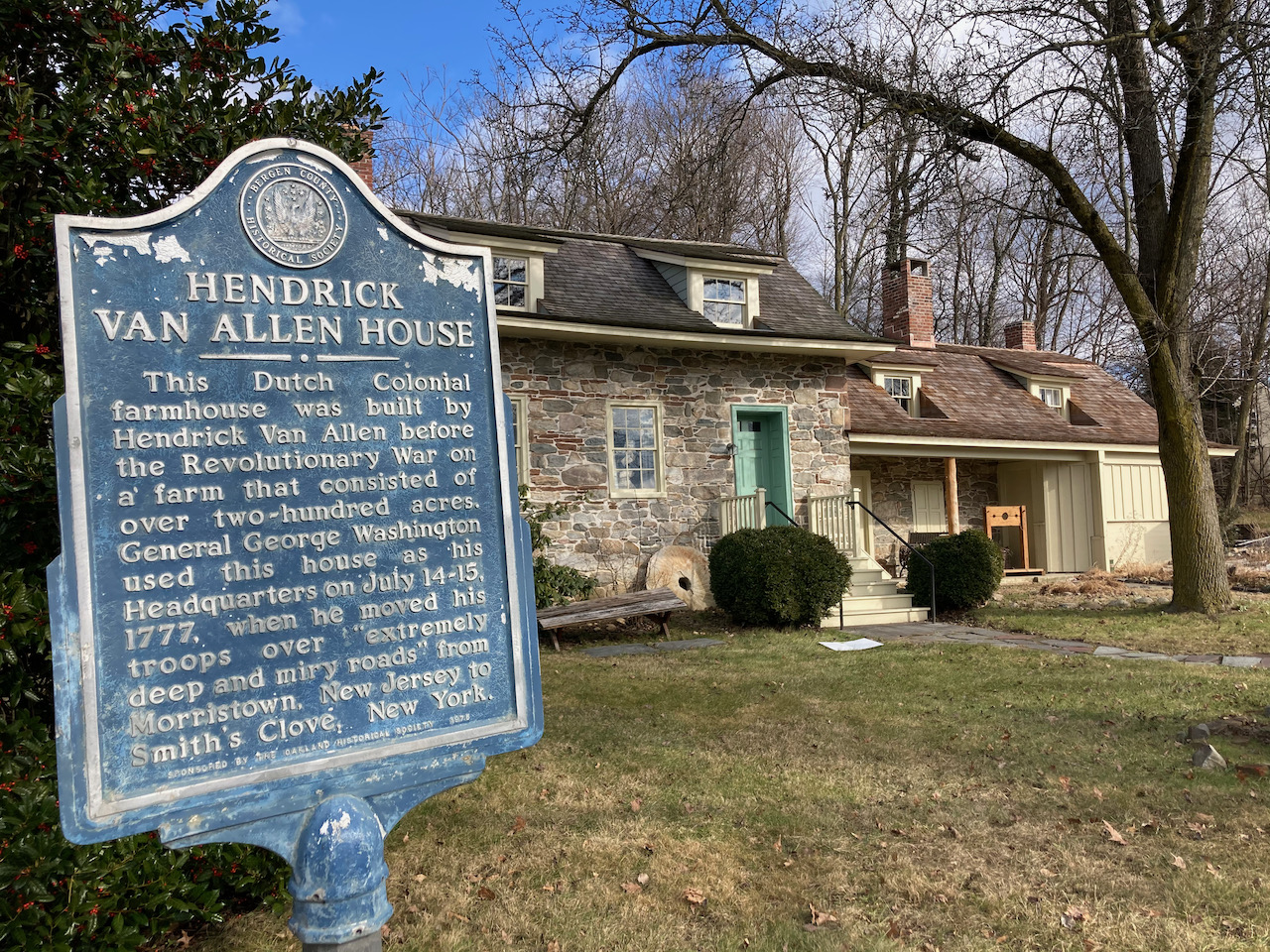 Exterior of Van Allen House, which informational sign on left of image.
