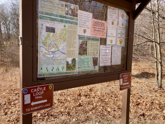 Information board on trail, with map of park.