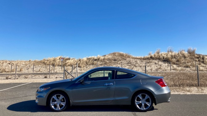 2012 Honda Accord coupe, parked in front of sand dune.