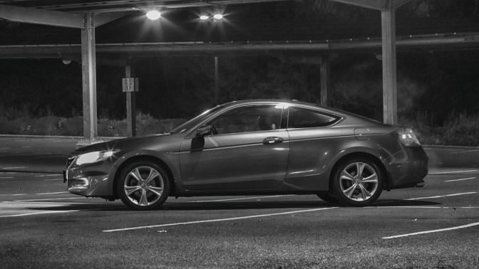 2012 Honda Accord coupe at night in black and white.