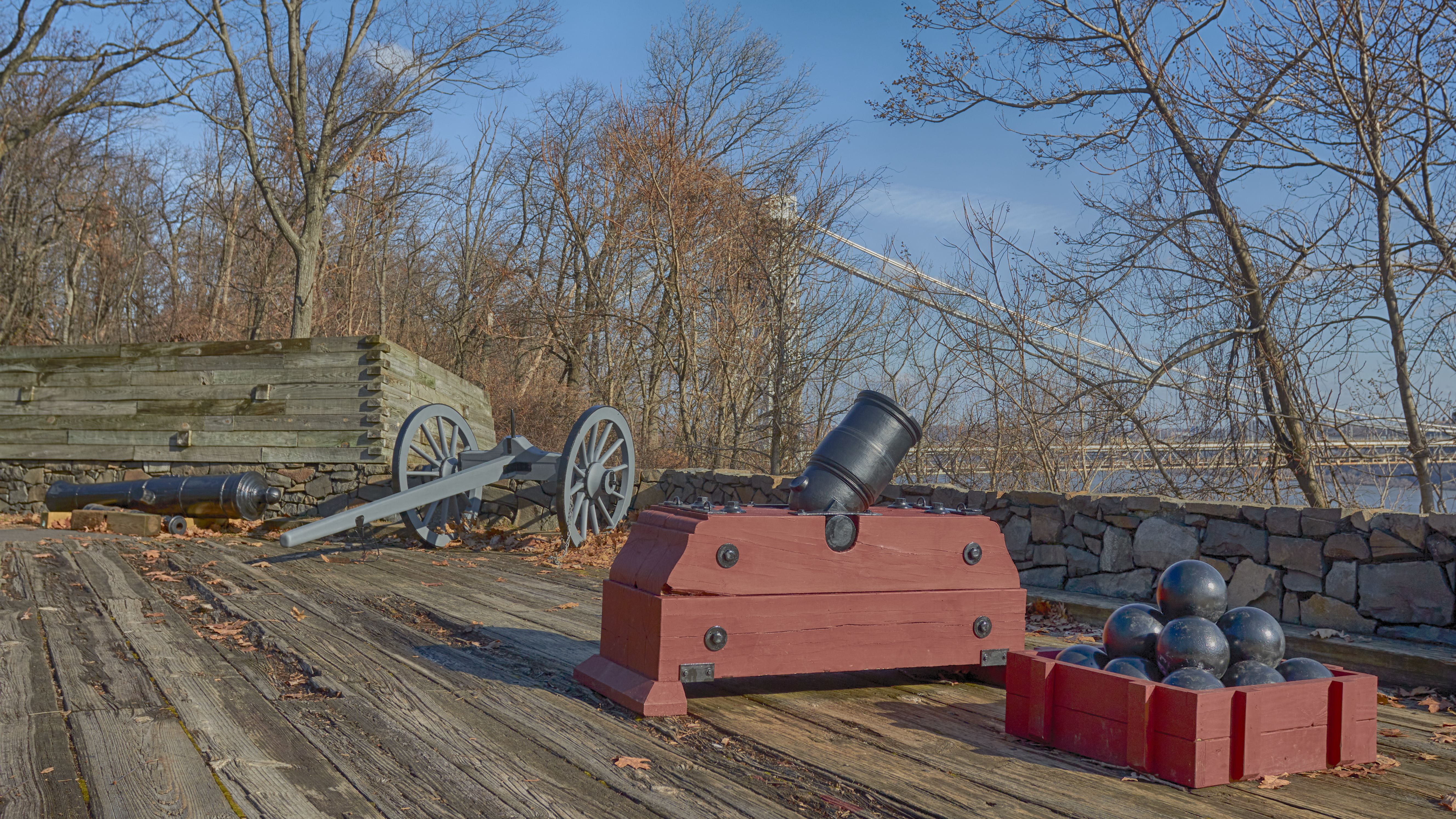 Gunnery emplacement in Fort Lee, including a mortar with cannon balls, and a cannon.