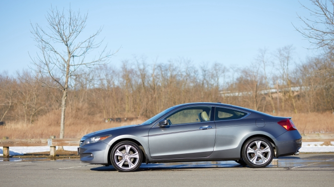 2012 Honda Accord coupe, parked beside wooded area.