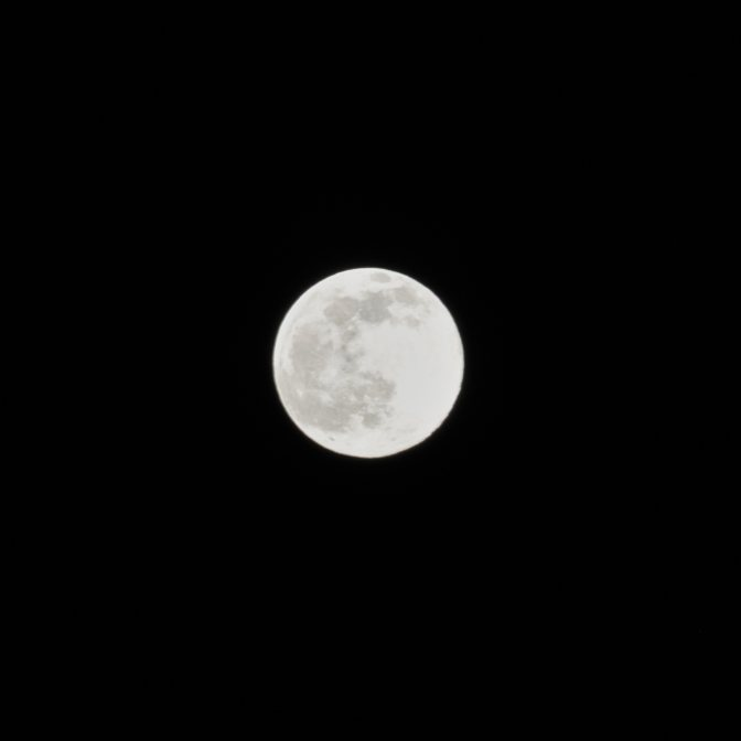 Moon in sky at night.