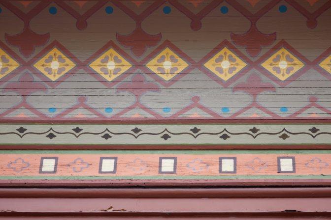 Patterned design beneath eaves.