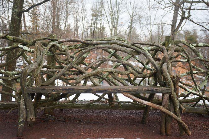 Wooden bench and fence made from tree branches.