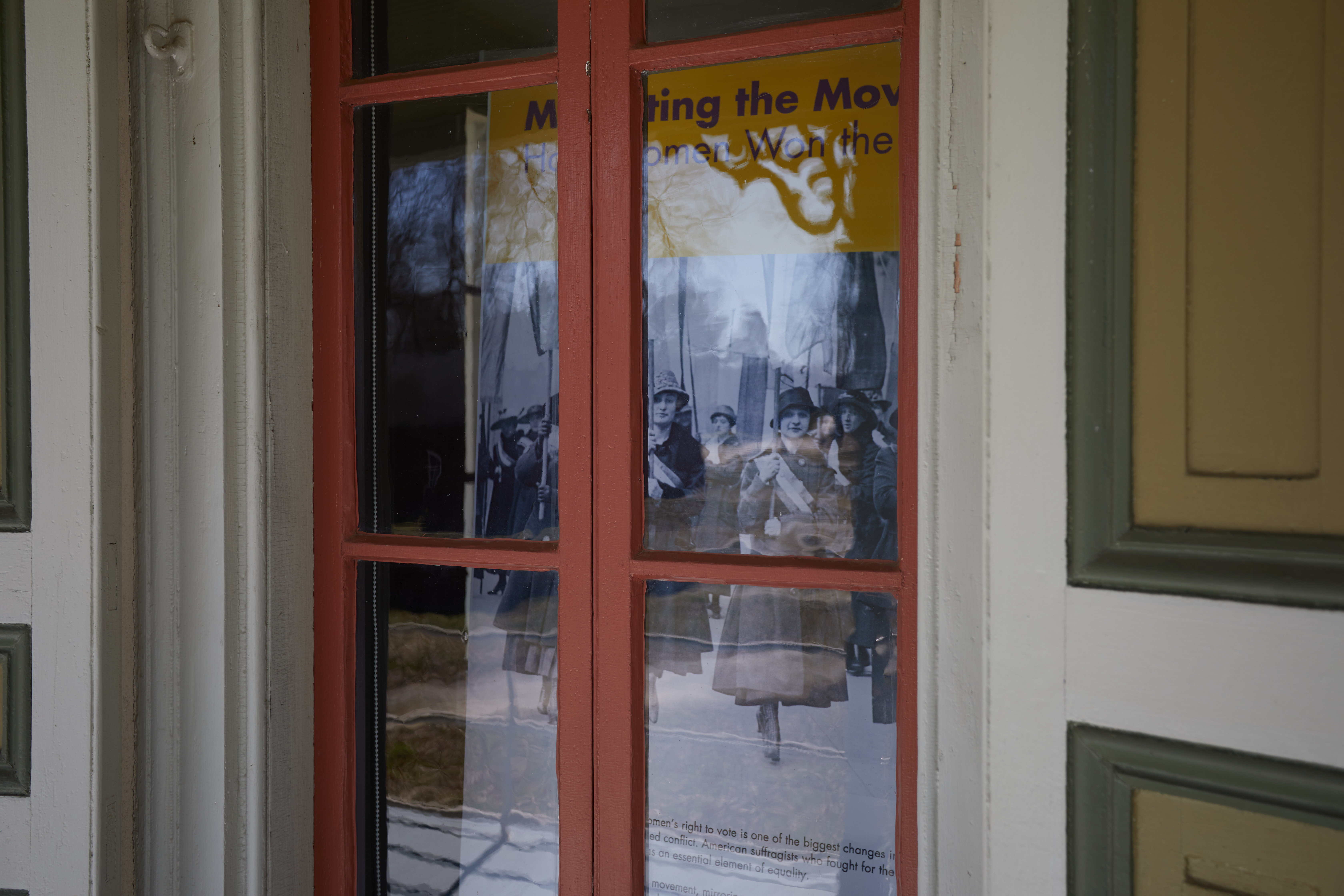 Display on women's suffrage, viewed through the window of Paulsdale.