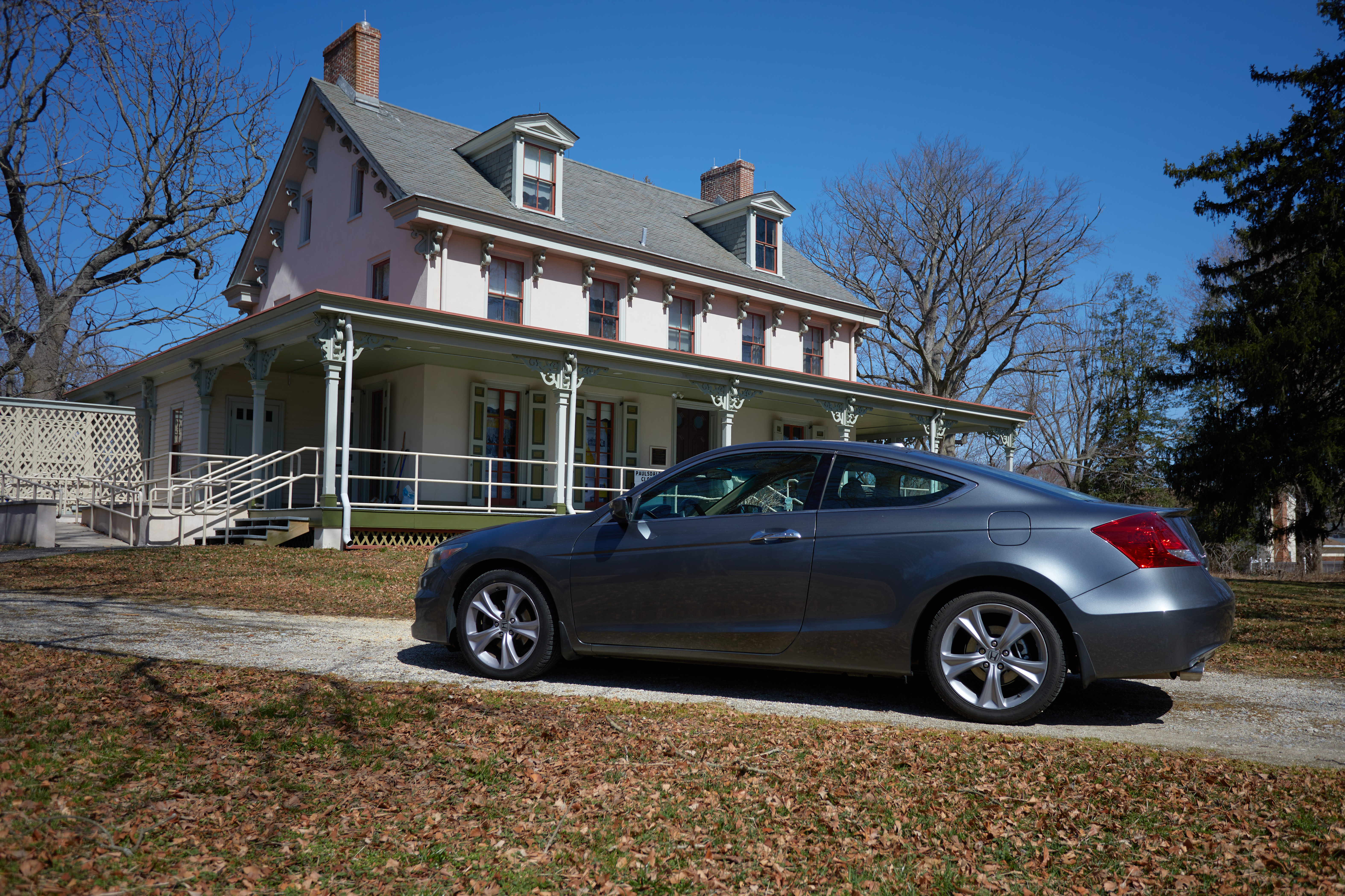 2012 Honda Accord parked in front of two-story mansion.