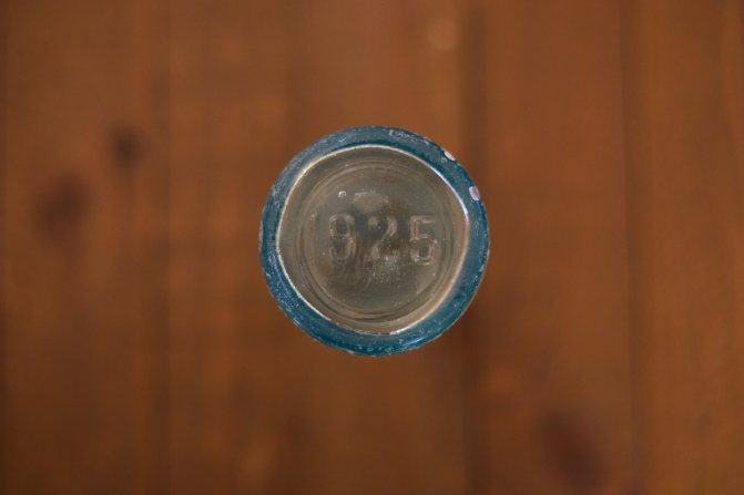 Bottom of glass bottle that reads 1925.