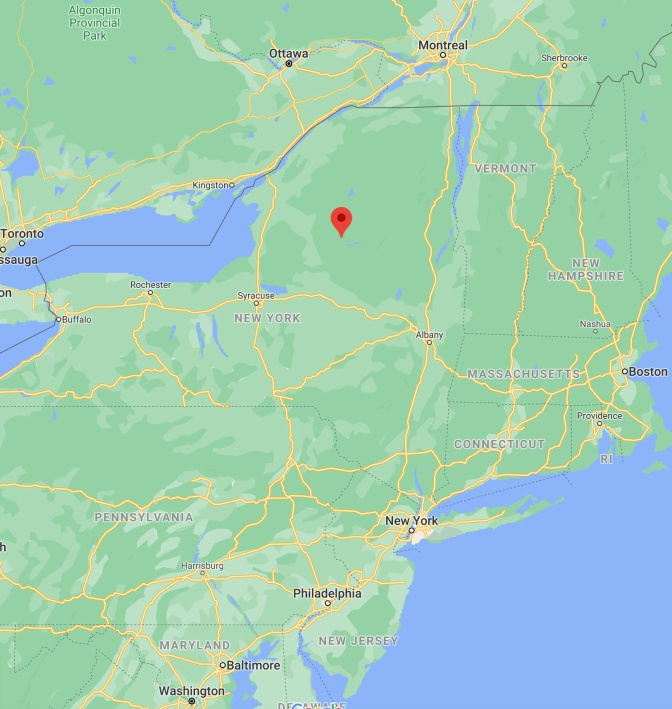 Map of New York state, with red pin in location of Adirondack Park.