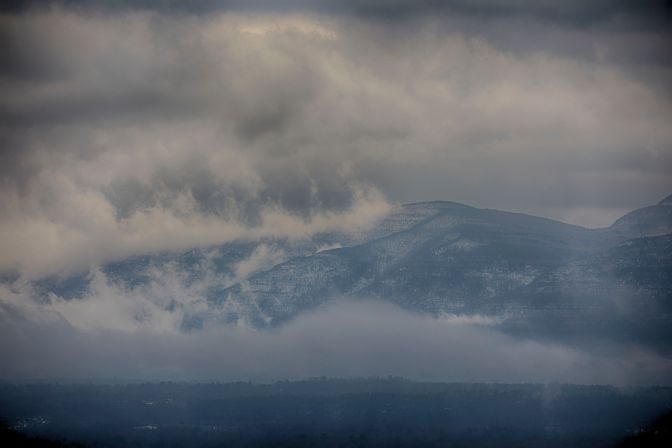 View of Catskill Mountains shrouded in fog.
