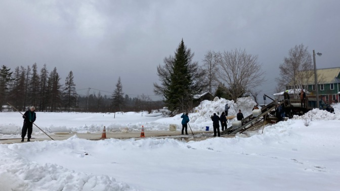 Ice cutting operation along shore of Raquette Lake.